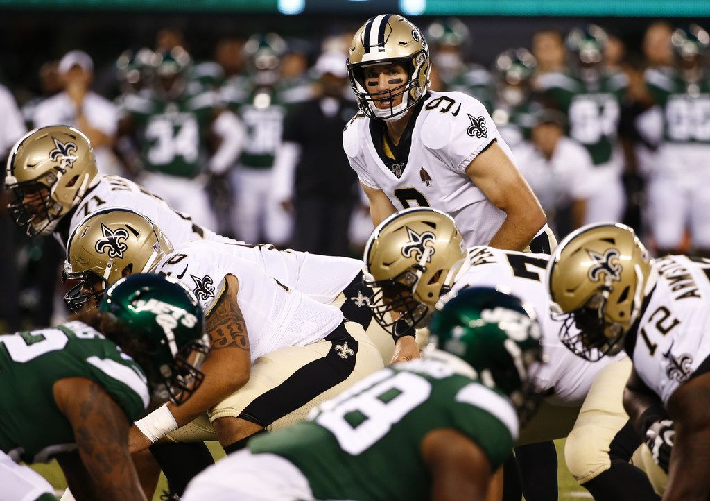 EAST RUTHERFORD, NJ - AUGUST 24:  Drew Brees #9 of the New Orleans Saints calls a play against the New York Jets during a pre-season game at MetLife Stadium on August 24, 2019 in East Rutherford, New Jersey.