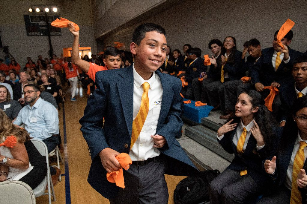Oliver Murillo, a 14-year-old incoming freshman at Cristo Rey Dallas College Prep, heads to the stage to receive his work assignment during the school's Draft Day ceremony, Friday, July 28, 2017 at Cristo Rey Dallas College Prep in Dallas. Through Cristo Rey's Corporate Work Study Program, students work one day a week with local businesses to earn a portion of their tuition.
