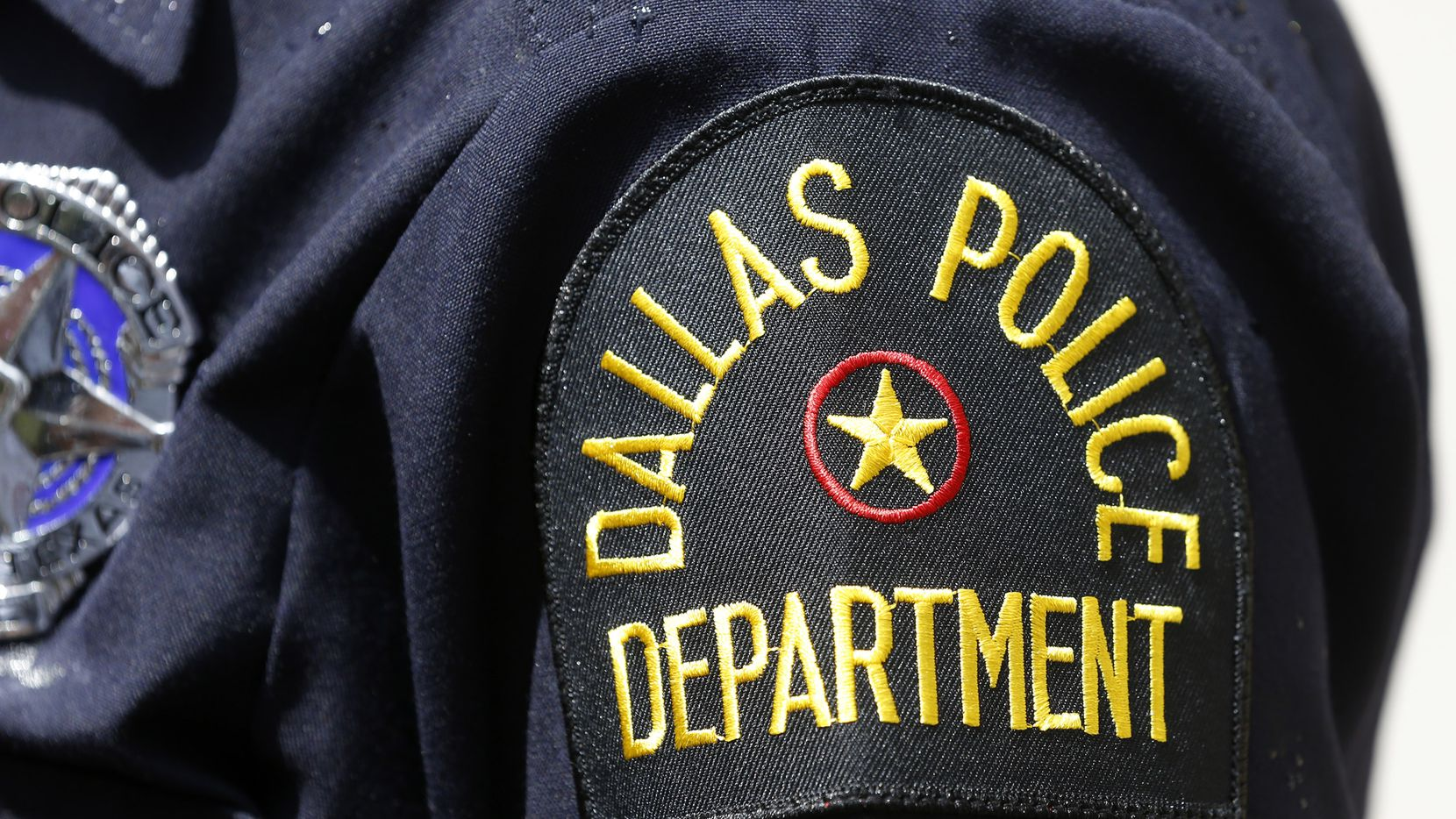 A police officer stands outside Dallas Police headquarters