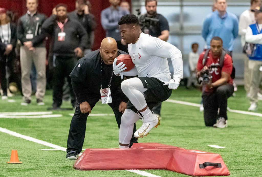 Alabama's Damien Harris works through individual drills at the Alabama NFL Pro Day, Tuesday, March 19, 2019, in Tuscaloosa, Ala. (AP Photo/Vasha Hunt)
