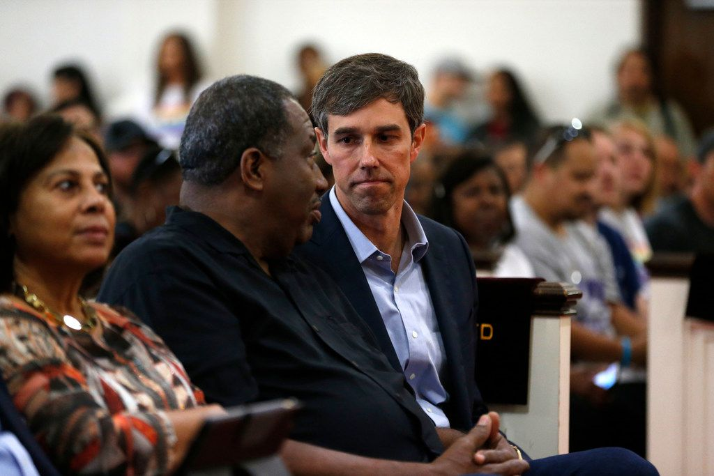 Beto O'Rourke talked to state Sen. Royce West (left) before speaking to the crowd during South Dallas With Beto! at Good Street Baptist Church in Dallas on Sept. 14, 2018.