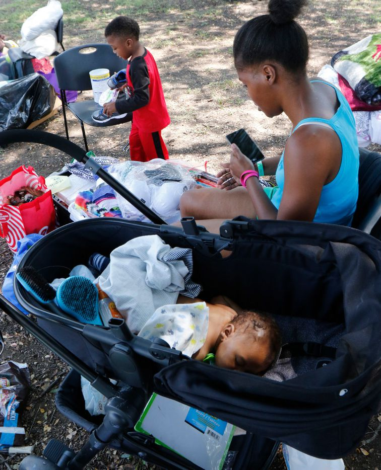 Hermanigue Lowe, 31, of Galveston waits with her two sons, Johnauon Pinder, 3, and Jamier Preston, 3 months, for her mother to pick them up at the Walnut Hill Recreation Center after it closed Monday. Some of the Harvey evacuees staying there were relocated to other shelters, and some returned to the coast. Lowe arrived Thursday after Hurricane Harvey flooded her home.