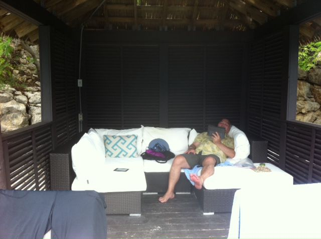 """DMN editorial writer Michael Hashimoto loafing in a beachfront cabana the day before, in his words, """"my neck exploded."""""""