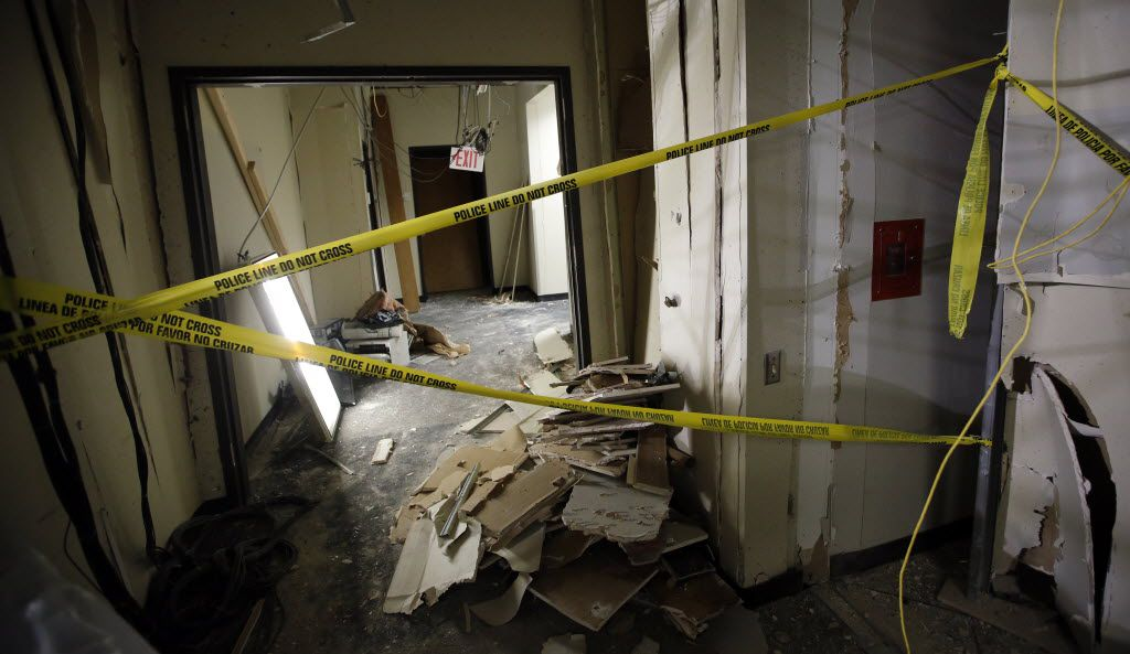 Structural damage is left behind where the gunman was cornered by police in a second story hallway at El Centro College in downtown Dallas, July 19, 2016. The police detonated a bomb, killing the gunman and causing all the structural damage. (Tom Fox/The Dallas Morning News)