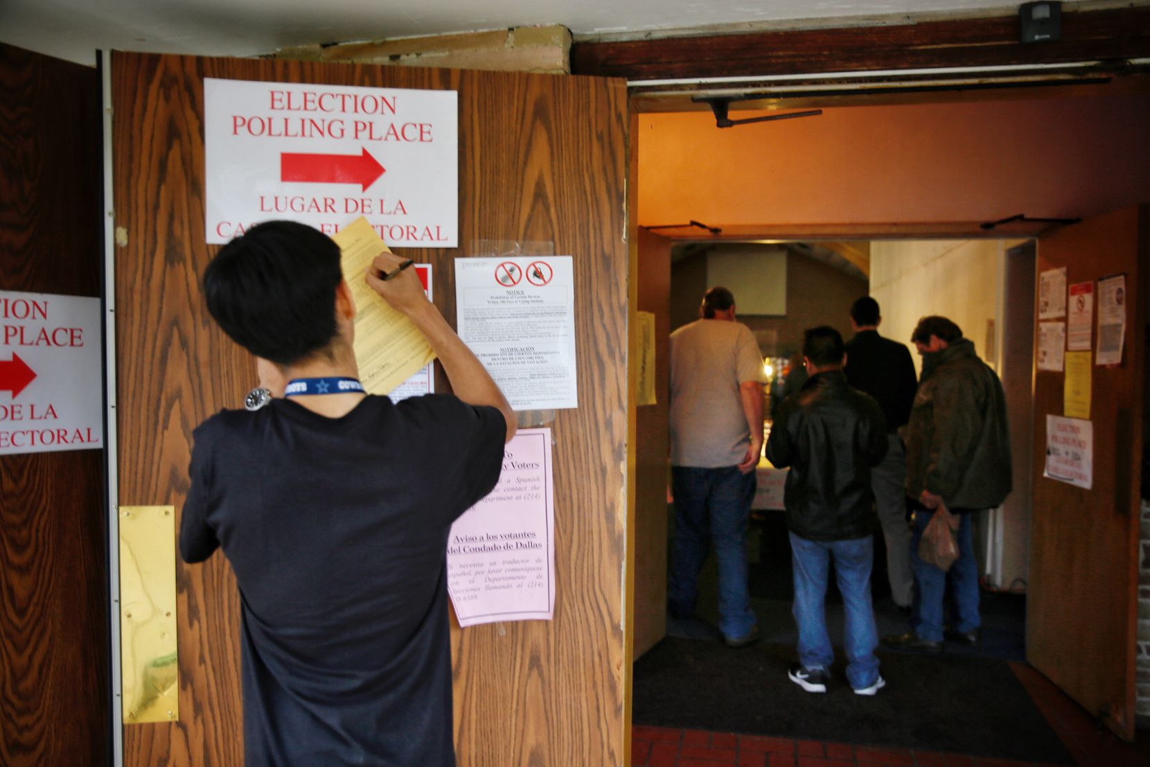 Elias Luevano, a student volunteer from Skyline High School, fills out paperwork as people wait in line to vote at Vickery Baptist Church Tuesday, November 8, 2016 in northeast Dallas. Voters across the country will decide the outcome of the presidential election, as well as various statewide and local races and measures.