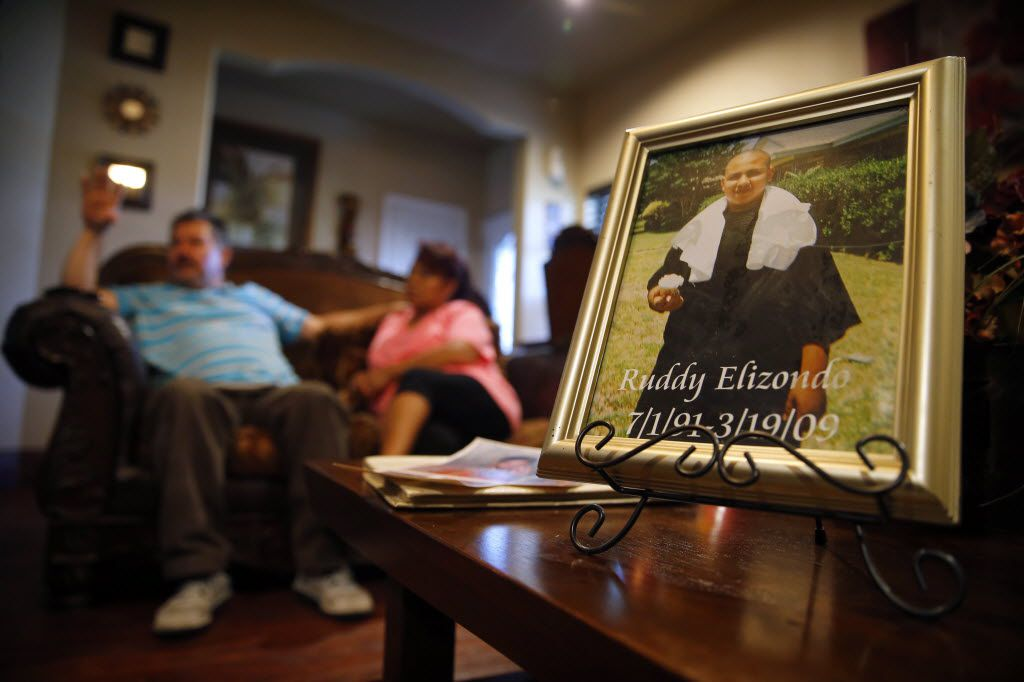 A photo of Ruddy Elizondo  sits on the table of his parents' home in Garland, Friday, July 1, 2016, as Ruddy's mother Alicia Elizondo and father Jose Elizondo talk about their son.
