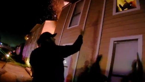 A Balch Springs police officer frantically urges a 10-year-old boy to jump from his second-floor apartment window after a fire broke out Monday.