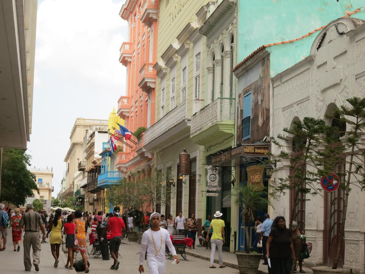 The streets of Havana are lined with architecturally interesting buildings painted in pastel colors.