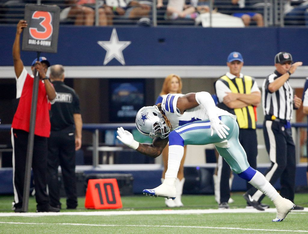 """Dallas Cowboys outside linebacker Jaylon Smith (54) celebrates with """"the swipe,"""" after tackling Indianapolis Colts tight end Jack Doyle (84) on a third down play during the first half of a preseason game at AT&T Stadium in Arlington on Saturday, August 19, 2017. (Vernon Bryant/The Dallas Morning News)"""