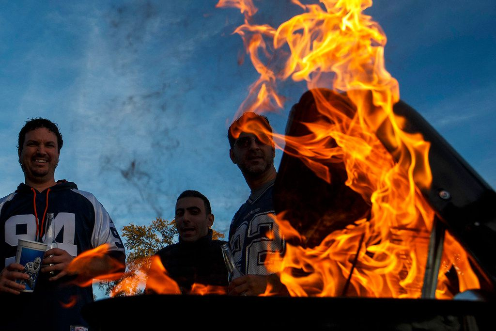 Flames reached high as fans fired up a grill before a game between the Dallas Cowboys and the Philadelphia Eagles at AT&T Stadium on Nov. 19.