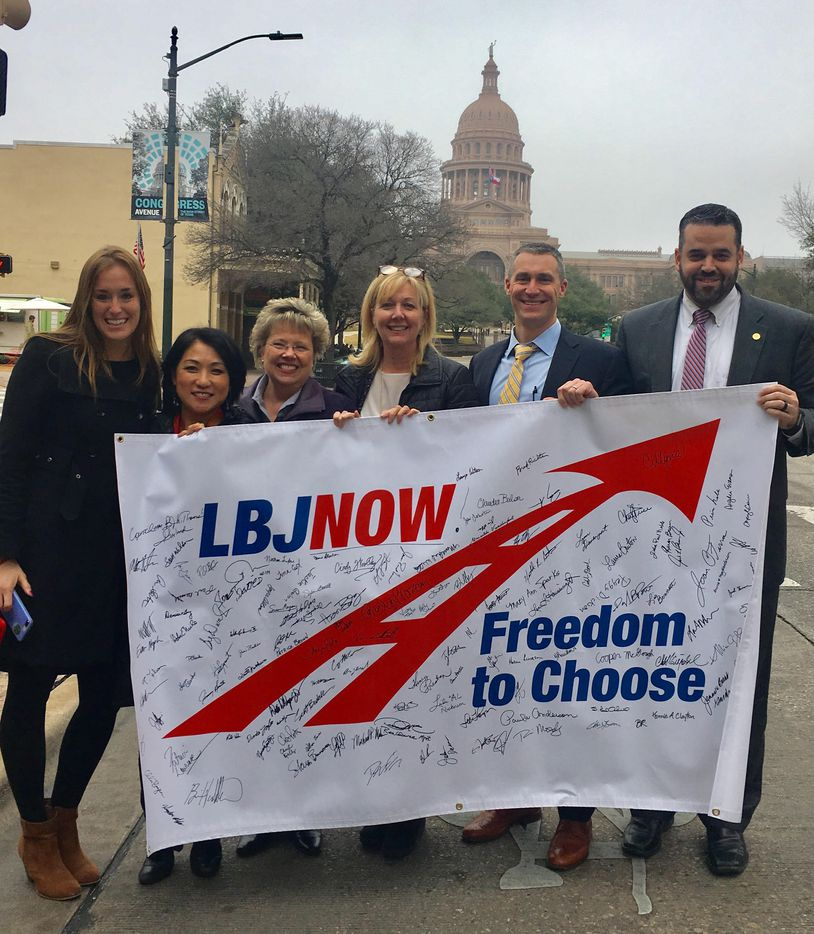 Lake Highlands residents, including Dallas City Council member Adam McGough (right), took their LBJ Now banner with supporters' signatures to the Texas Transportation Commission meeting in Austin on Thursday.