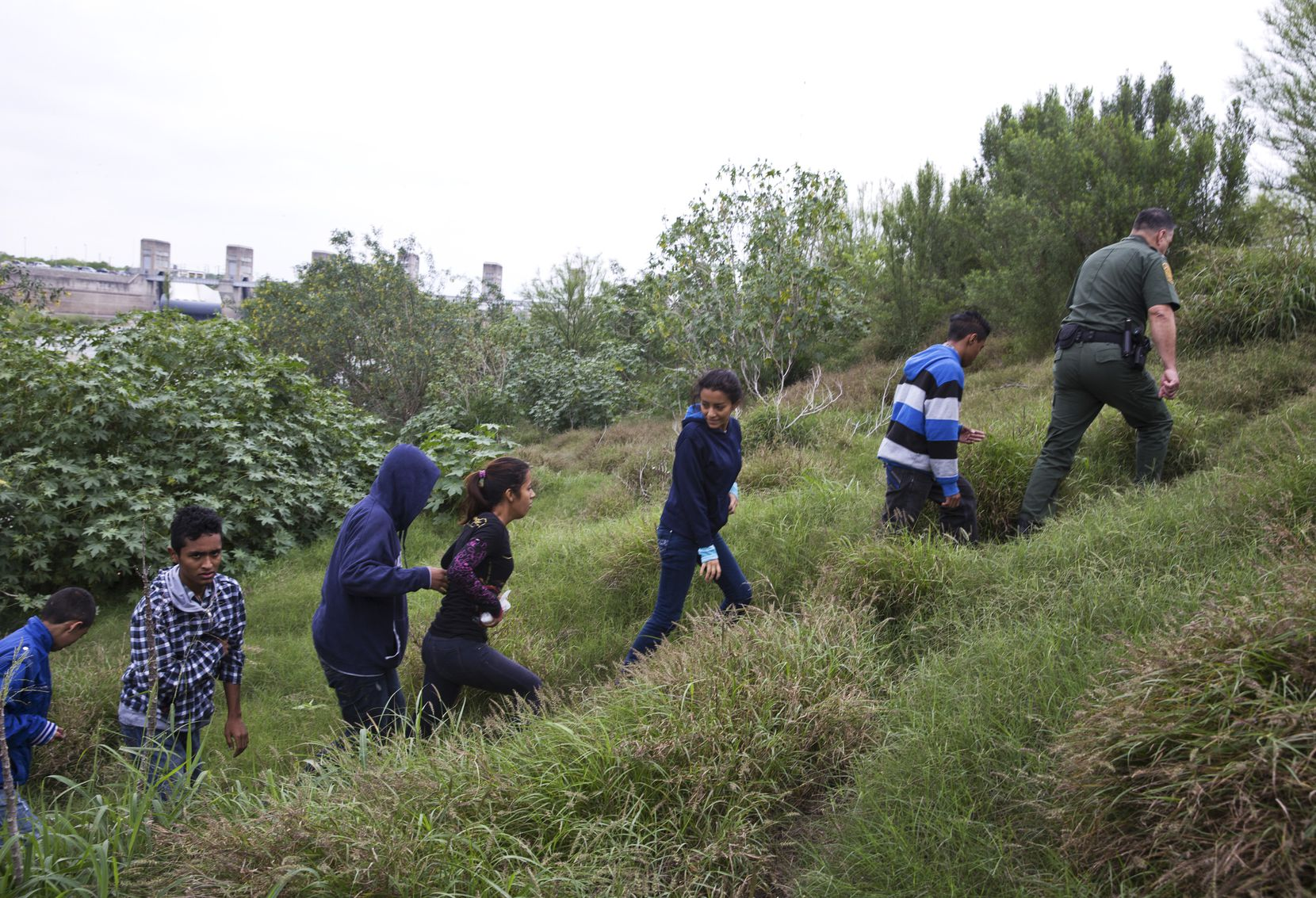 Migrants from Honduras and Guatemala are detained by the U.S. Border Patrol after crossing the Rio Grande at the border in south Texas.