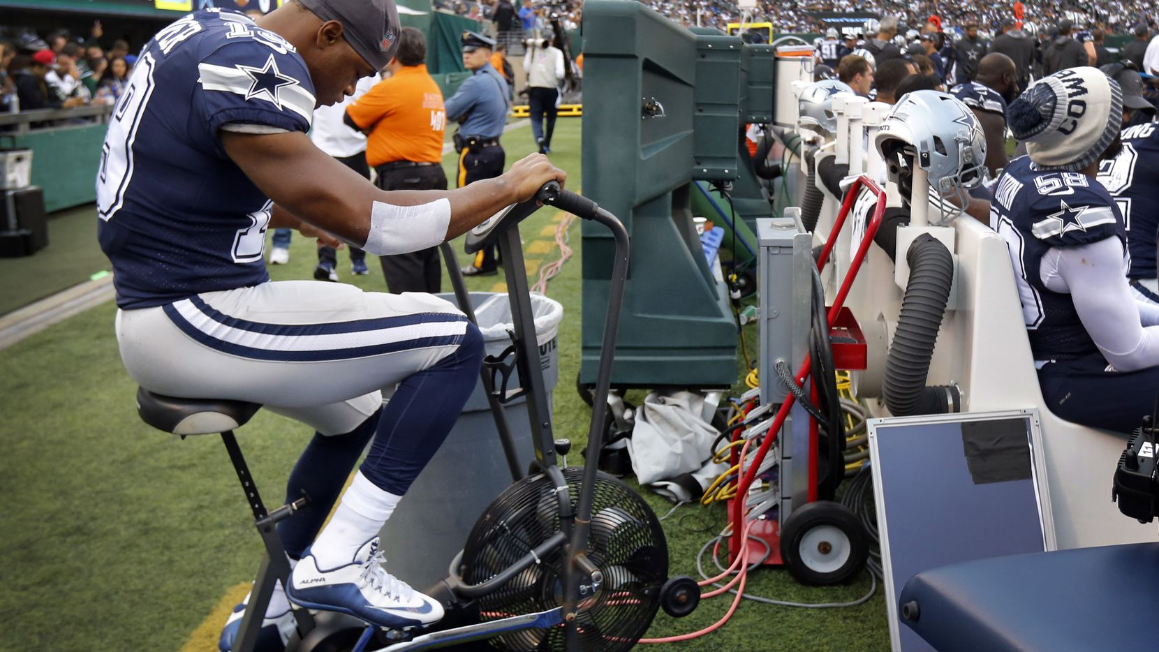 Dallas Cowboys wide receiver Amari Cooper (19) peddles on the bike after sustaining an injury during the first quarter against the New York Jets at MetLife Stadium in East Rutherford, New Jersey, Sunday, October 13, 2019.
