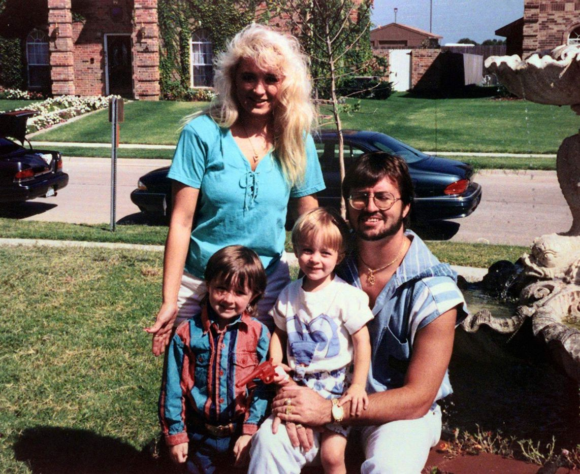 Darlie Routier poses with husband Darin and sons Damon (left) and Devon in a 1993 family photo at their Rowlett home.