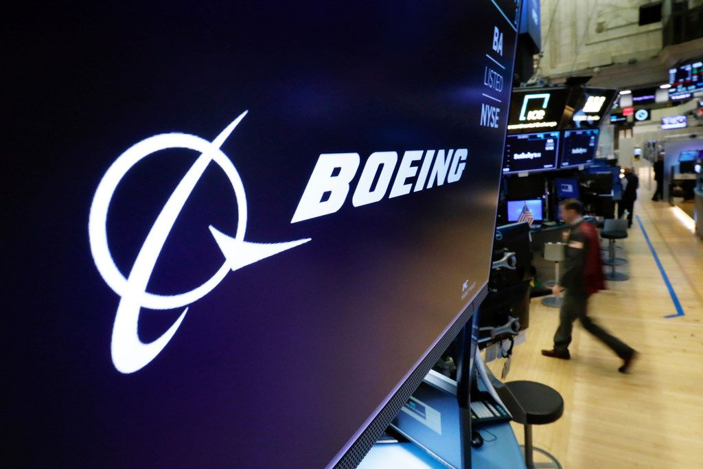 The Boeing logo appears above a trading post on the floor of the New York Stock Exchange before the opening bell on Monday.