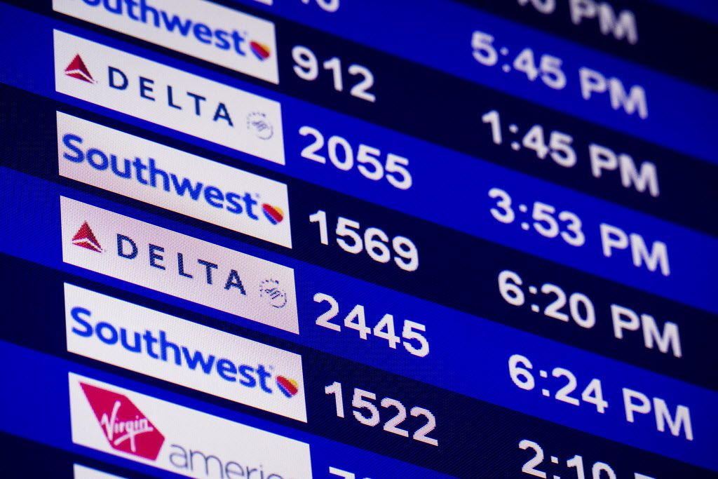 A message board shows the status for Delta, Southwest and Virgin America departing flights at Dallas Love Field on Wednesday, June 24, 2015, in Dallas. (Smiley N. Pool/The Dallas Morning News)