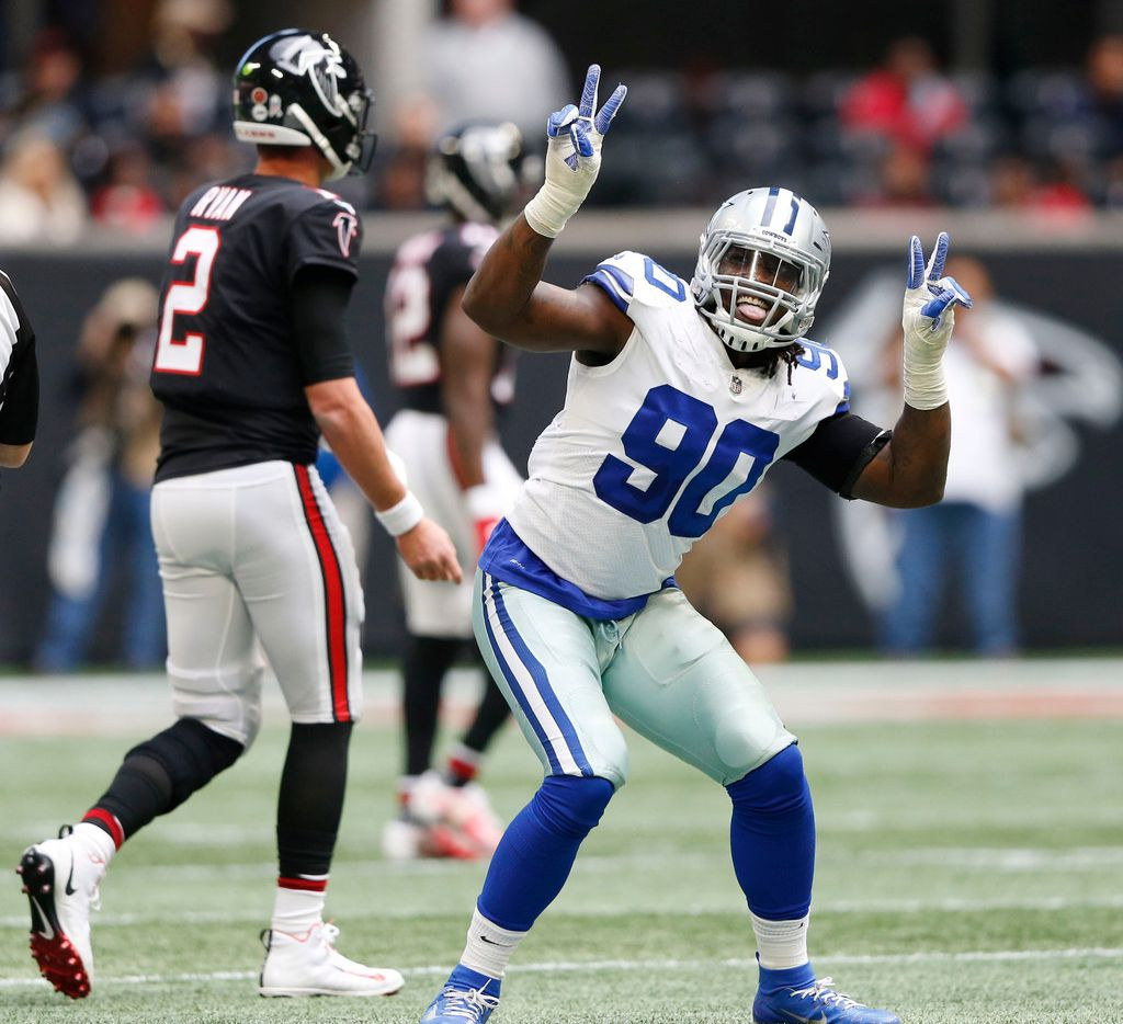 Dallas Cowboys defensive end Demarcus Lawrence (90) dances after he sacked Atlanta Falcons quarterback Matt Ryan (2) to force a fourth down play during the first half of play at Mercedes-Benz Stadium in Atlanta on Sunday, November 18, 2018. (Vernon Bryant/The Dallas Morning News) ORG XMIT: DMN1811181333525716