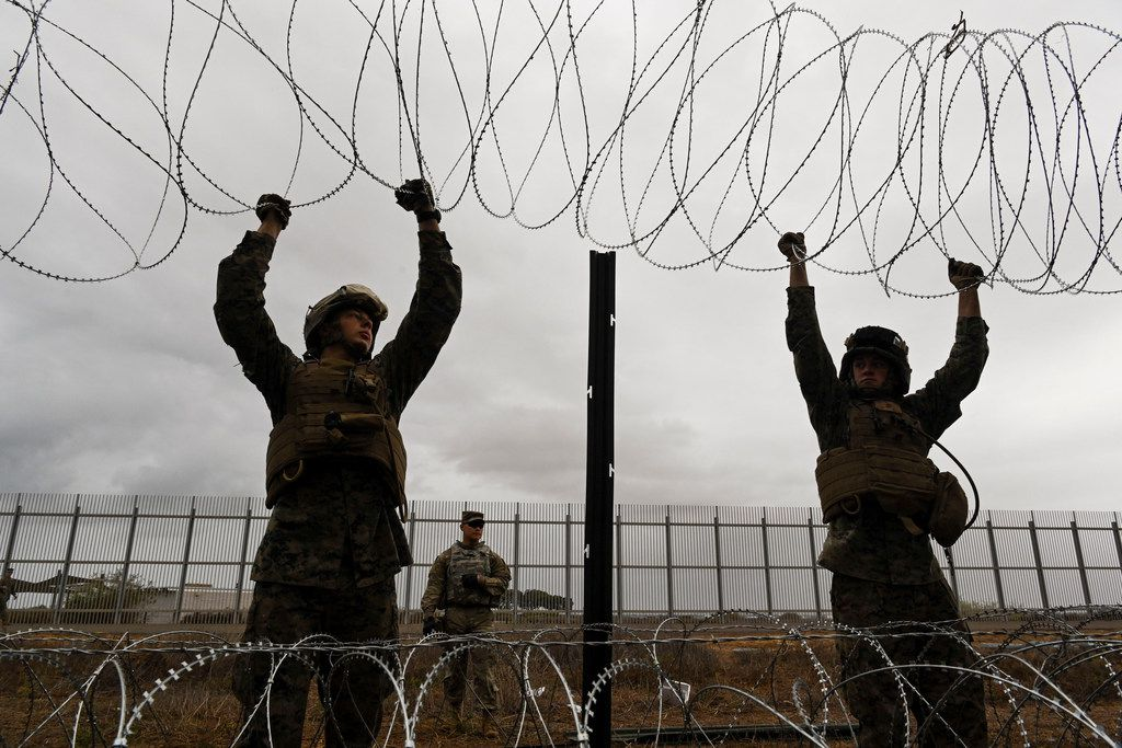 The House scheduled a committee hearing Tuesday morning to examine the ongoing military deployment at the border. Members of the United States military place concertina wire along the border fence along Tijuana, Mexico.