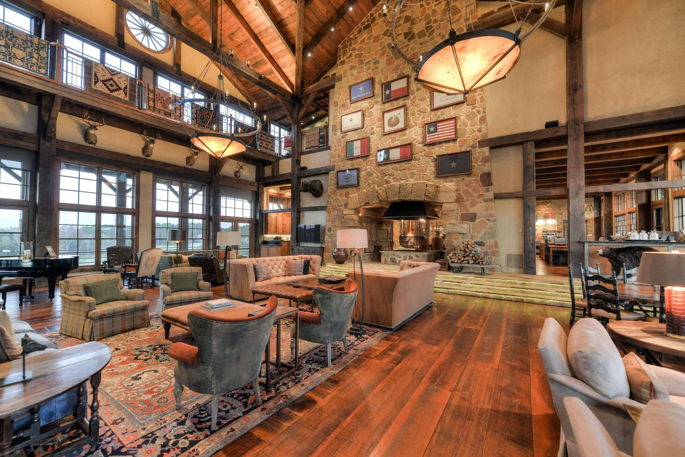 Barefoot Ranch has a 35,000-square-foot, timber-beamed lodge, golf course, boat house, multiple cabins and cottages, tennis courts, a driving range and equestrian center.