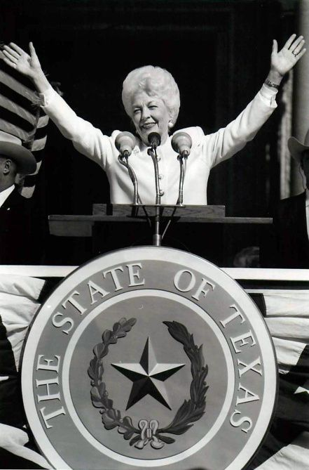 Richards waves to the cheering crowd after being sworn in on the south steps of the Capitol in Austin.
