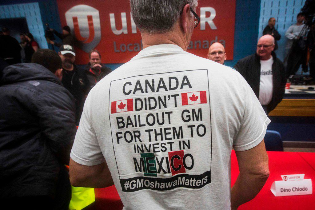 """A worker wears a T-shirt during an information session at Local 222 in Oshawa, Ontario, on November 26, 2018. - In a massive restructuring, US auto giant General Motors announced it will cut 15 percent of its workforce to save $6 billion and adapt to """"changing market conditions."""" The moves include shuttering seven plants worldwide as the company responds to changing customer preferences and focuses on popular trucks and SUVs and increasingly on electric models.  GM will shutter three North American auto assembly plants next year: the Oshawa plant in Ontario, Canada; Hamtramck in Detroit, Michigan and Lordstown in Warren, Ohio. (Photo by Lars Hagberg / AFP)LARS HAGBERG/AFP/Getty Images"""