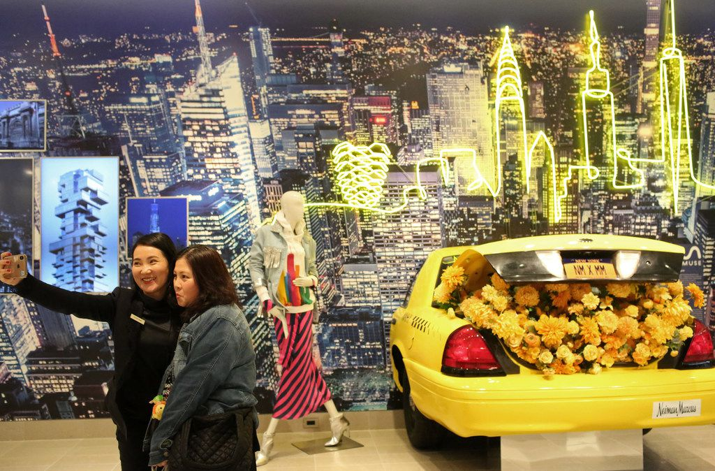 People gather and take selfies at the opening of Neiman Marcus at the Shops at Hudson Yards.