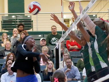 Iman Ndiaye (1) from Plano West hits a shot as Prosper's Shaylee Shore (right) and Bailey Birmingham defend during Plano West's 25-16, 25-22, 25-14 victory Tuesday. (Steve Hamm/ Special Contributor)