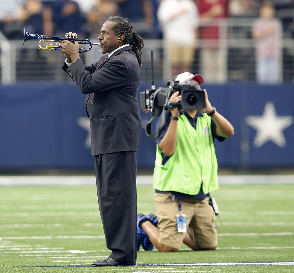 Trumpeter Freddie Jones perform the national anthem before the Dallas Cowboys Los Angeles Rams game at AT&T Stadium in Arlington, Texas, Sunday, October 1, 2017.