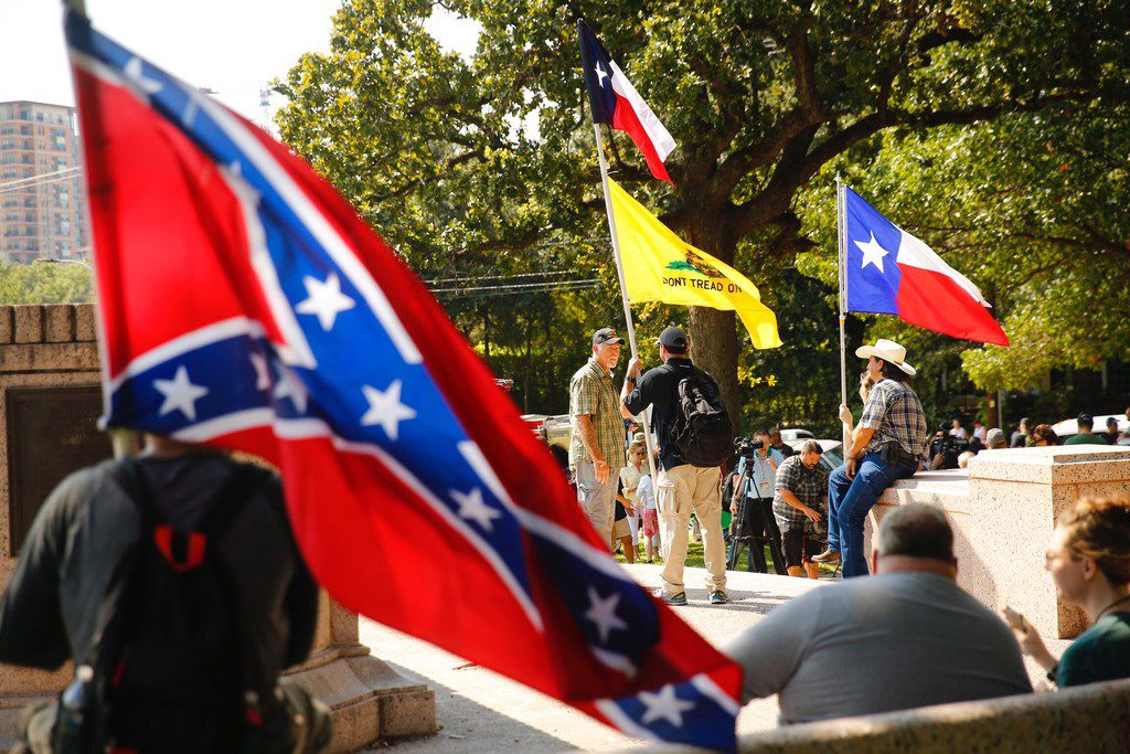 People gathered for the This Is Texas Freedom Force protest Saturday over the removal of the Robert E. Lee statue from Lee Park in Dallas.  The statue was removed from the park, Thursday.