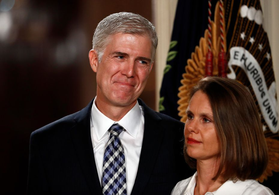 Judge Neil Gorsuch stands with his wife Louise as President Donald Trump speaks in the East Room of the White House in Washington, Tuesday, Jan. 31, 2017, to announce Gorsuch as his nominee for the Supreme Court.(AP Photo/Carolyn Kaster)