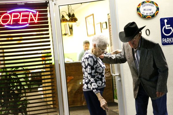 Amelia and Ray Perry, married for 64 years,  help each other as they leave leave Mi Familia Mexican Restaurant in Haskell, Texas.