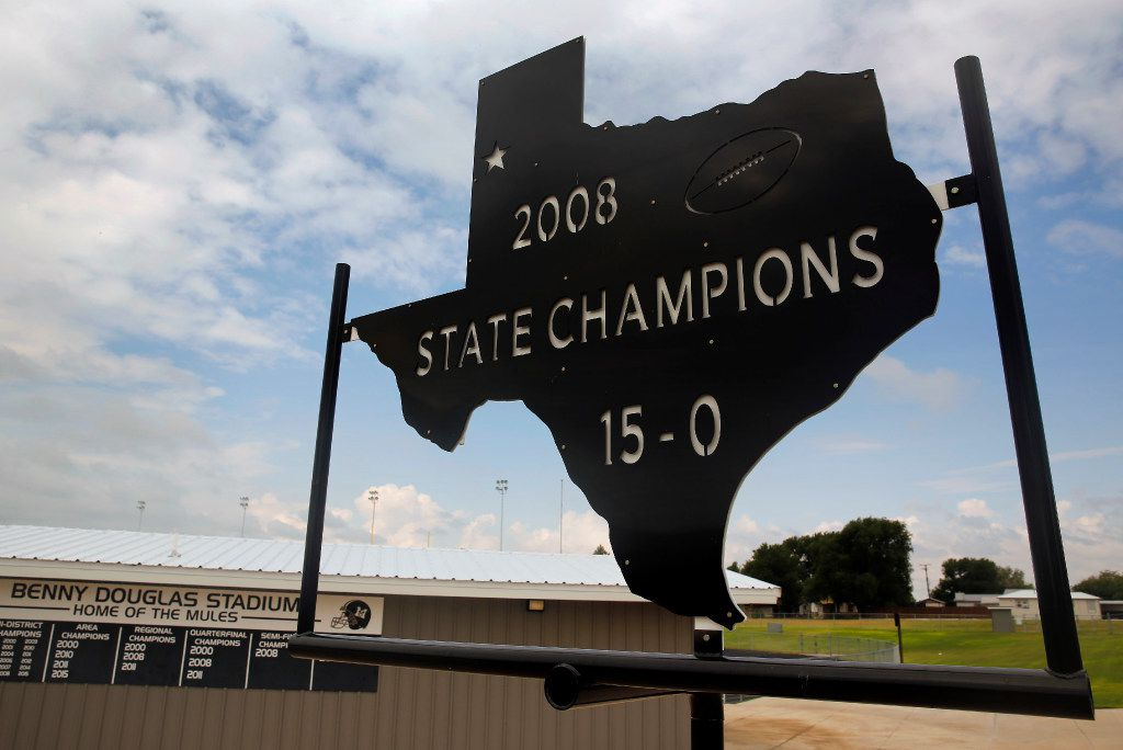 A steel cut-out reminds fans of the Muleshoe Mules 2008 State Championship win outside their Muleshoe, Texas field offices, Tuesday, August 1, 2017. The Mules former quarterback Lincoln Riley is now the new Oklahoma Sooners head football coach. (Tom Fox/The Dallas Morning News)