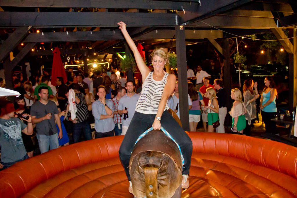 The mechanical bull draws a crowd at The Trophy Room in Uptown.