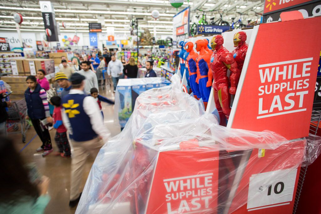 Customers save big at Walmart's Black Friday shopping event on Thursday, Nov. 26, 2015 in Rogers, Ark. Hundreds of customers at Walmart stores across the country took advantage of deals on top items, like televisions, video game consoles, and toys.