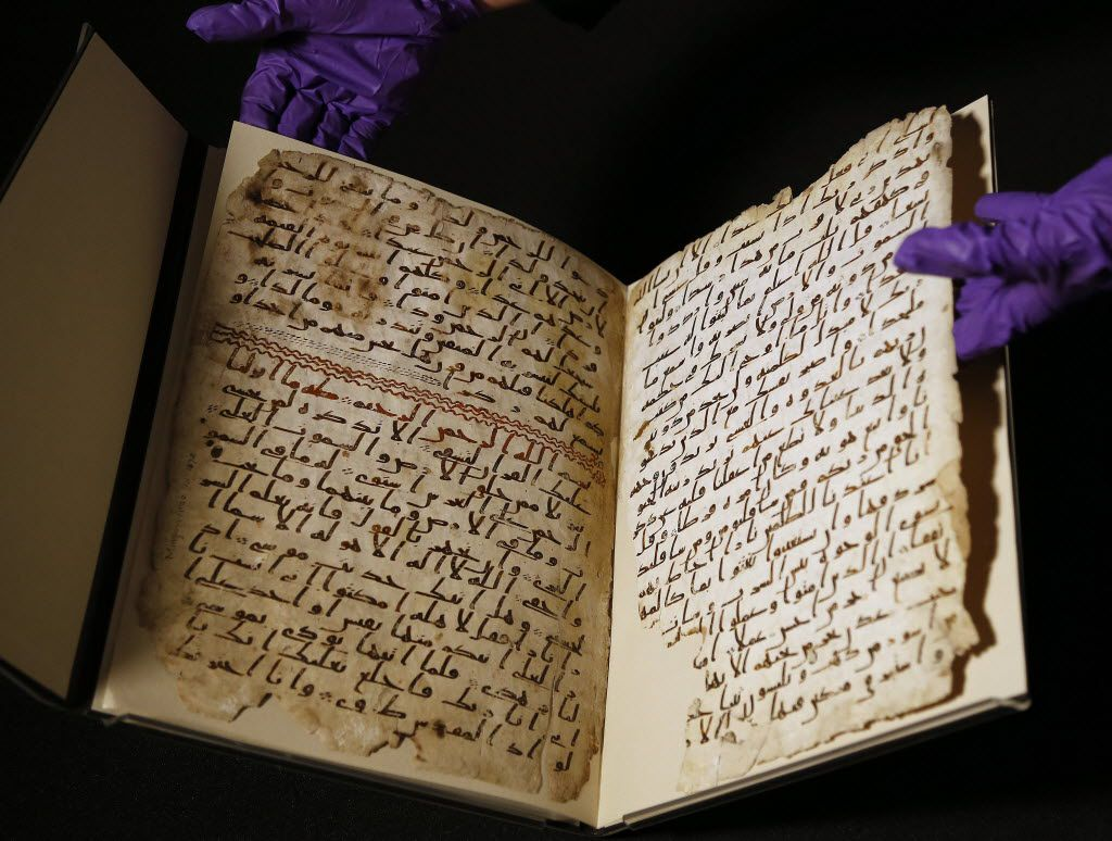 A university assistant shows fragments of an old Quran at the University in Birmingham, in Birmingham central England Wednesday, July 22, 2015. (AP Photo/Frank Augstein)