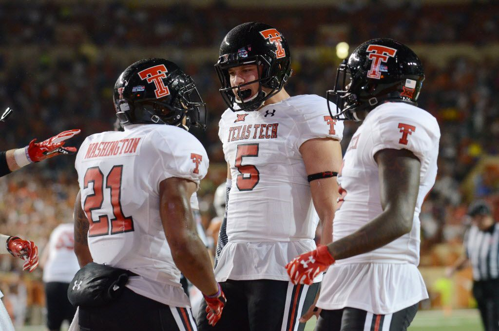 Nov 26, 2015; Austin, TX, USA; Texas Tech Red Raiders running back DeAndre Washington (21) and quarterback Patrick Mahomes II (5) react against the Texas Longhorns during the second half at Darrell K Royal-Texas Memorial Stadium. Texas Tech beat Texas 48-45. Mandatory Credit: Brendan Maloney-USA TODAY Sports