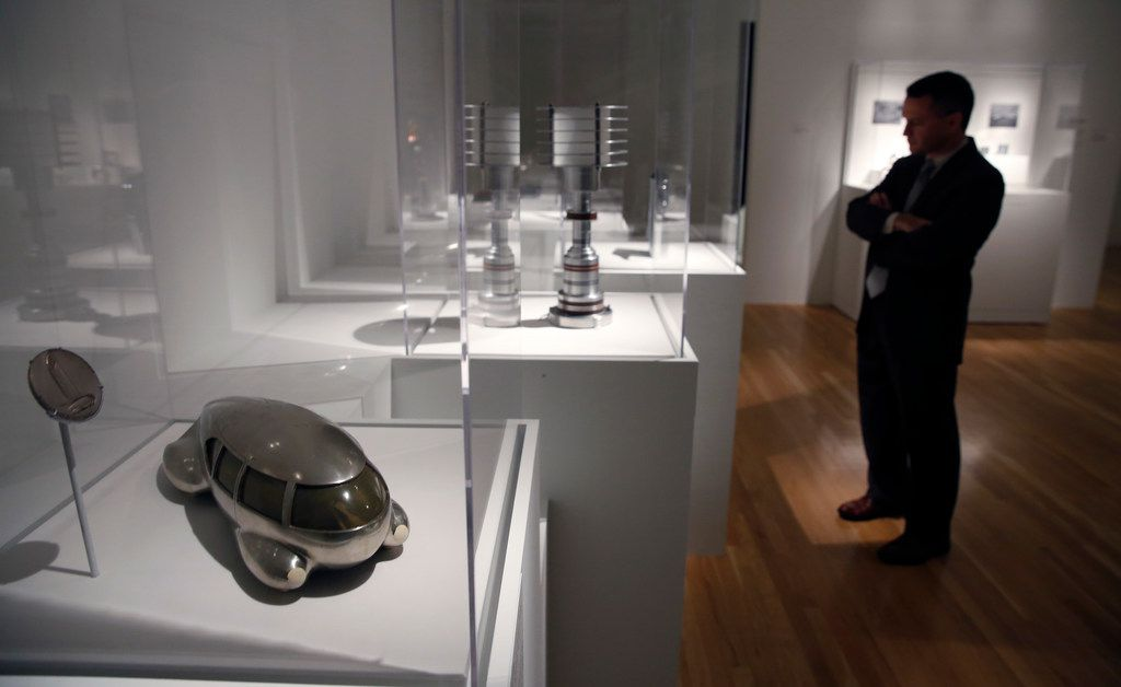 Mark Mitchell looks at sculptures including Motor Car No. 8 (front, left) by Norman Bel Geddes