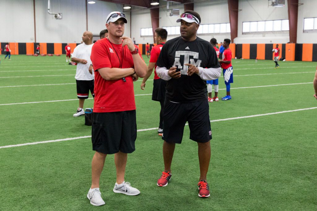 University of Houston football head coach Tom Herman (left) chats with Texas A&M football head coach Kevin Sumlin during a football satellite camp jointly hosted by Texas A&M and University of Houston at Lancaster High School on June 9, 2016 in Lancaster, Texas. (Ting Shen/The Dallas Morning News)
