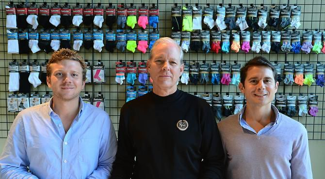 "Hugh Gaither (center), with sons Joe (left) and John, says their company, which makes specialty athletic socks, weathered the recession quite nicely: ""People kept running, and we kept growing. People, even when they were out of work, wanted to stay healthy."""