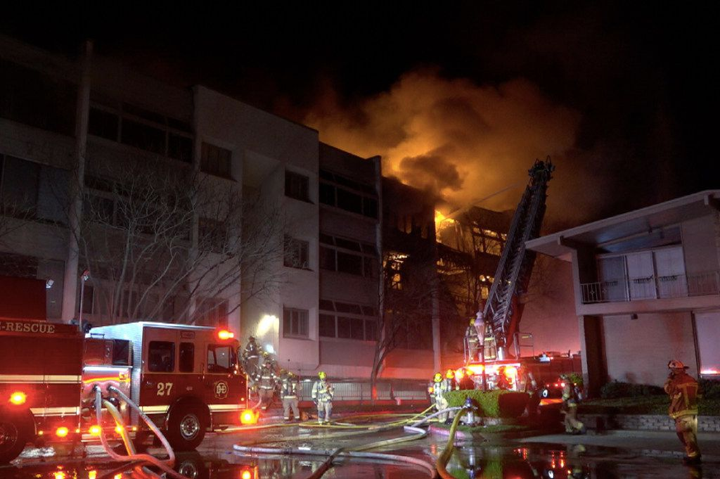 Dallas Fire-Rescue personnel fight a 7-alarm fire at the Preston Place condos in the 6200 block of West Northwest Highway early Saturday, March 4, 2017.