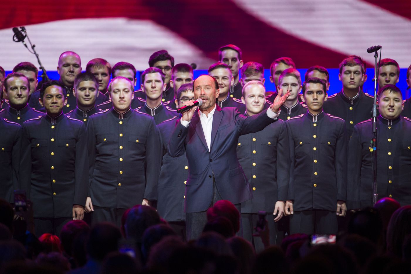"""Lee Greenwood sings """"I'm Proud to be an American"""" on Saturday, October 21, 2017 at Reed Arena on the Texas A&M University campus in College Station, Texas."""