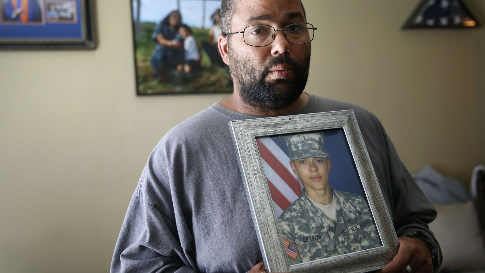 Ricky DeLeon holds a portrait of his son, Isaac Lee DeLeon, at his home in San Angelo on Tuesday, May 2, 2017.  The 19-year-old Army private died in a flooding accident during a training exercise at Fort Hood.