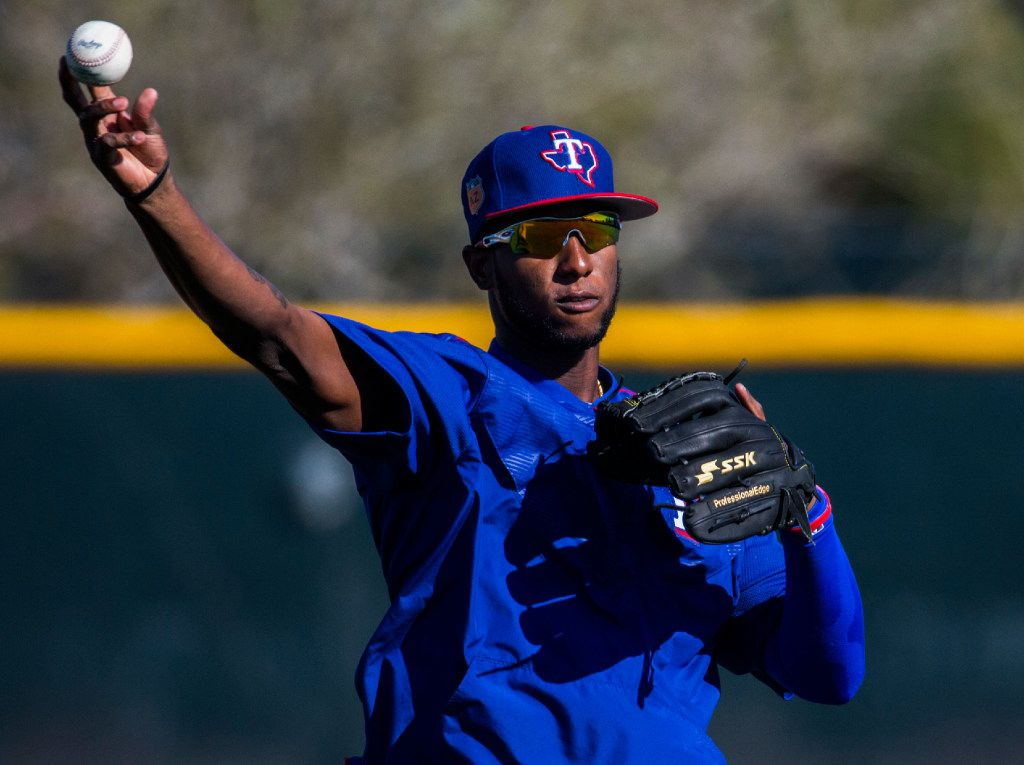 Texas Rangers third baseman Jurickson Profar (19) throws a ball to home base during a spring training workout at the team's training facility on Thursday, February 23, 2017 in Surprise, Arizona. (Ashley Landis/The Dallas Morning News)