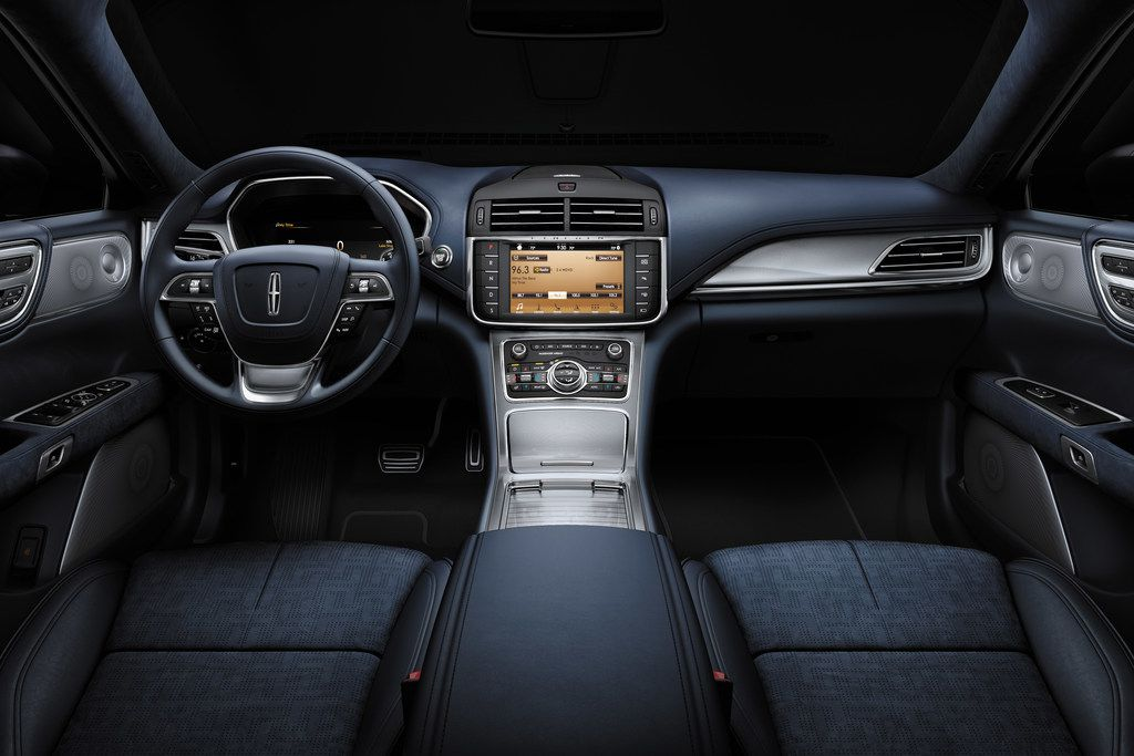 The car's Infotainment system includes a 19-speaker Revel Ultima sound system.