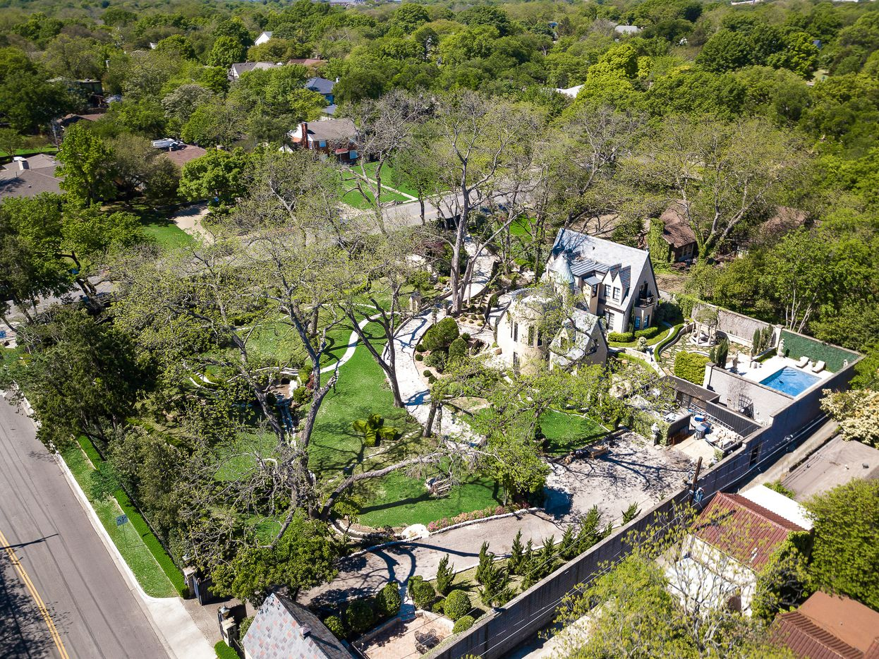 The 1-acre estate includes extensive grounds and gardens.