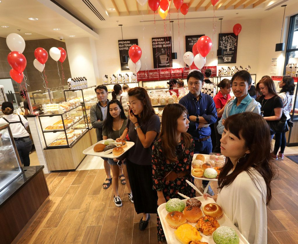 Some customers described a sense of pride at the opening Friday -- of being able to buy Asian cakes for just $2 or $3, at a shop that was closer to home.
