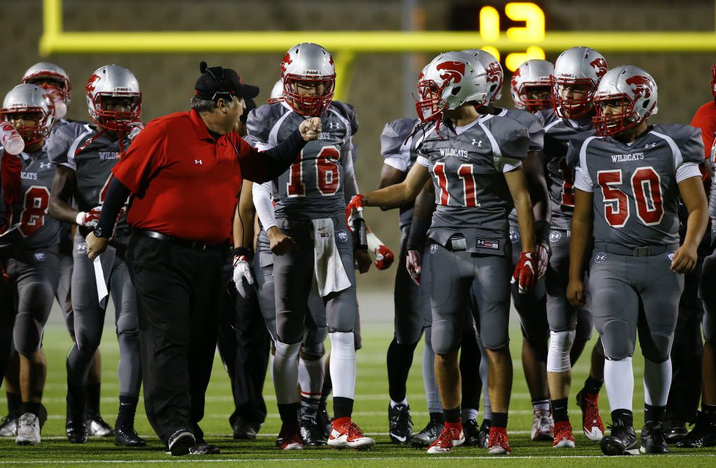 TXHSFB Woodrow Wilson head coach Bobby Estes talks with his team in the first half of their high school football game against Terrell in Garland, Texas, Thursday, November 12, 2015. Mike Stone/Special Contributor
