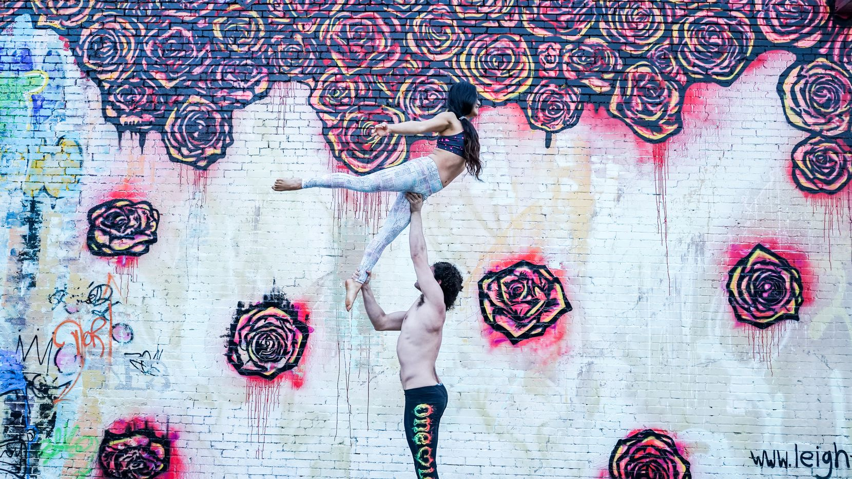 The murals of Deep Ellum provide a cool backdrop for AcroYoga for Max Lowenstein and Liz Kong