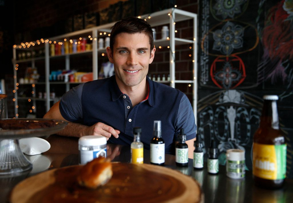 Roots Juices owner Brent Rodgers poses with some of the products he sells at shops in Oak Lawn and Lakewood.