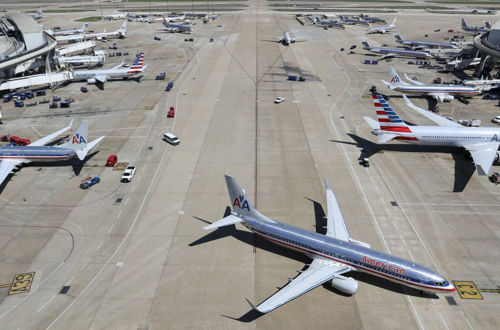 American Airlines planes on on terminals A and C are seen from on top of the American Airlines control tower at Dallas / Fort Worth Airport on Wednesday, March 25, 2015. (Jim Tuttle/The Dallas Morning News)